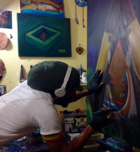 JahSun painting in his studio.
